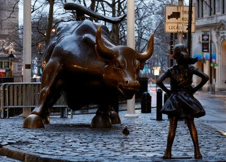 A statue of a girl facing the Wall St. Bull is seen in the financial district in New York