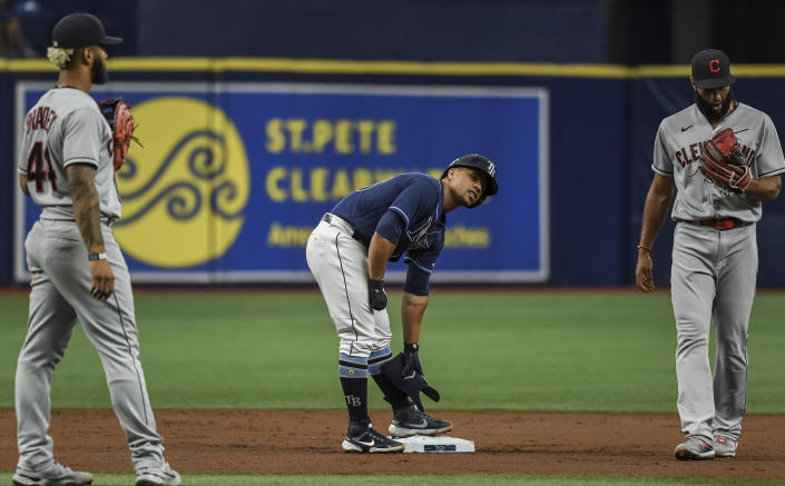 Tampa Bay Rays' Francisco Mejia stands on second between Cleveland Indians infielders Bobby Bradley, left, and Amed Rosario, right, after hitting a double during the second inning in the second baseball game of a doubleheader Wednesday, July 7, 2021, in St. Petersburg, Fla.(AP Photo/Steve Nesius)