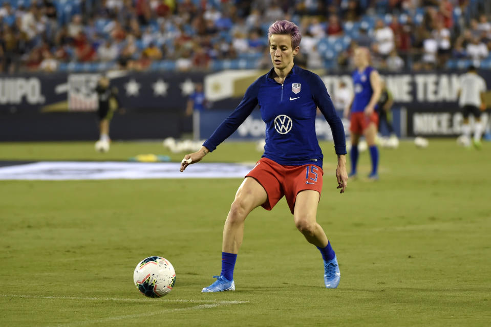 United States' Megan Rapinoe warms up prior to a women's soccer match between South Korea and the United States on Thursday, Oct. 3, 2019, in Charlotte, N.C. (AP Photo/Mike McCarn)