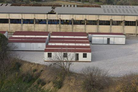 Prefabricated houses are seen at a site for registering refugees and migrants on the Greek island of Chios, in this handout photo released by the Greek Prime Minister's Office on December 15, 2015. REUTERS/Greek Prime Minister's Office/Handout via Reuters