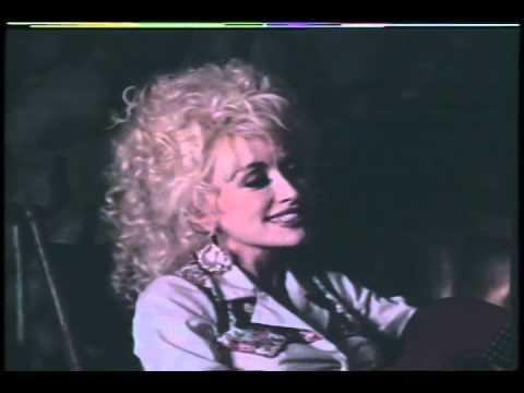 """<p>Long before Hallmark's <em>Christmas at Dollywood</em>, Parton starred in another holiday film, <em>A Smoky Mountain Christmas, </em>in 1986. In the movie, Parton plays Lorna Davis, a disheartened country star who escapes to a friend's cabin over the holidays. Instead of being greeted by her friend, however, Lorna finds seven orphans dwelling in the place. She cares for them and protects them against an evil witch woman. Parton later opened up a special <a href=""""https://www.dollywood.com/themepark/Festivals/Smoky-Mountain-Christmas"""" rel=""""nofollow noopener"""" target=""""_blank"""" data-ylk=""""slk:Smoky Mountain Christmas theme park"""" class=""""link rapid-noclick-resp"""">Smoky Mountain Christmas theme park</a> at Dollywood in honor of the movie. </p><p><a href=""""https://www.youtube.com/watch?v=Hcv9TIDap4o"""" rel=""""nofollow noopener"""" target=""""_blank"""" data-ylk=""""slk:See the original post on Youtube"""" class=""""link rapid-noclick-resp"""">See the original post on Youtube</a></p>"""