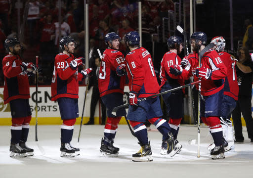 Washington Capitals left wing Alex Ovechkin (8), from Russia celebrates with his teammates at the end of Game 6 of the NHL Eastern Conference finals hockey playoff series against the Tampa Bay Lightning, Monday, May 21, 2018, in Washington. Capitals won 3-0. (AP Photo/Pablo Martinez Monsivais)