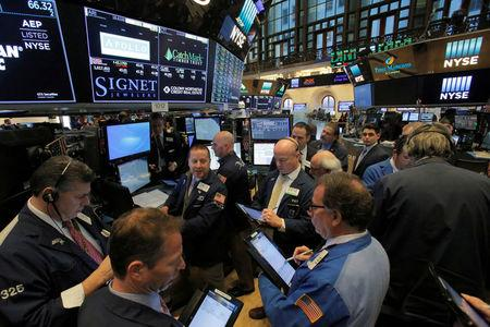 FILE PHOTO - Traders work on the trading floor at the New York Stock Exchange (NYSE) in Manhattan, New York City, U.S., March 14, 2018. REUTERS/Andrew Kelly