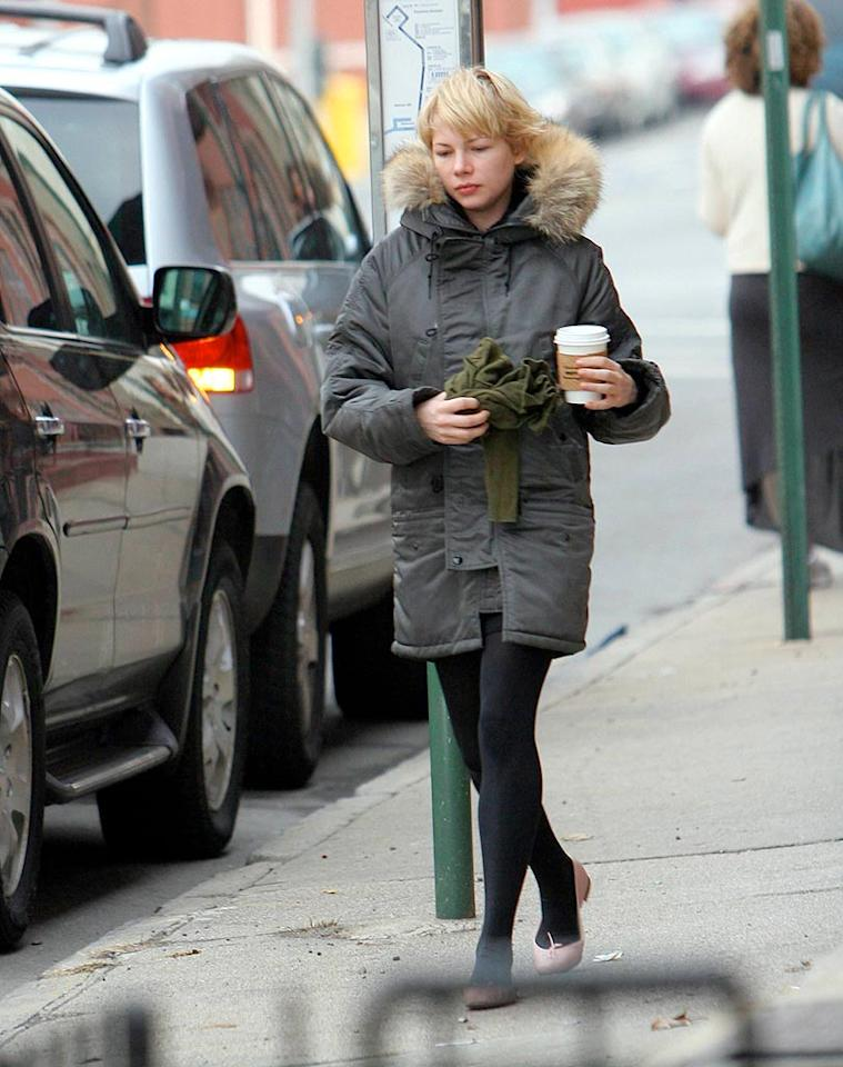 "Michelle Williams, the former ""Dawson's Creek"" star and former Mrs. Heath Ledger, uses a cup of coffee and a fur-trimmed coat to battle the weather. JSB/<a href=""http://www.x17online.com"" target=""new"">X17 Online</a> - December 11, 2007"