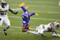 Minnesota Vikings wide receiver Justin Jefferson (18) is tripped up by New Orleans Saints cornerback Ken Crawley as strong safety Malcolm Jenkins (27) defends in the first half of an NFL football game in New Orleans, Friday, Dec. 25, 2020. (AP Photo/Brett Duke)