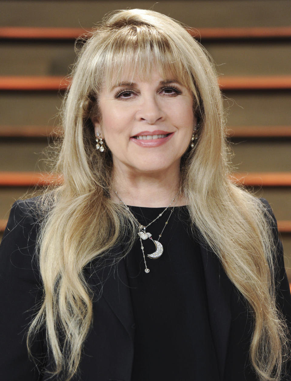 """FILE - Singer Stevie Nicks attends the 2014 Vanity Fair Oscar Party in West Hollywood, Calif., on March 2, 2014. Nicks has spent the last 10 months homebound, mainly due to the coronavirus pandemic. During that time, she recorded the new single """"Show Them the Way"""" and edited her new concert film """"Stevie Nicks 24 Karat Gold The Concert."""" The song will be released Friday and the concert film, recorded over two nights during Nicks' 2016-17 """"24 Karat Gold"""" tour, will be available at select theaters and drive-ins on Oct. 21 and 25. (Photo by Evan Agostini/Invision/AP, File)"""