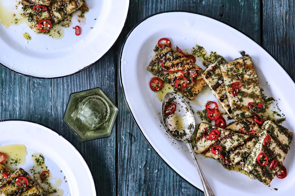 "No offense to all the vegetarians, but the chimichurri is also pretty fantastic on your favorite steak. <a href=""https://www.bonappetit.com/recipe/grilled-tofu-chimichurri?mbid=synd_yahoo_rss"" rel=""nofollow noopener"" target=""_blank"" data-ylk=""slk:See recipe."" class=""link rapid-noclick-resp"">See recipe.</a>"