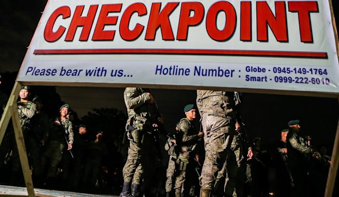 Soldiers wait to be deployed at checkpoints. Photo: EPA