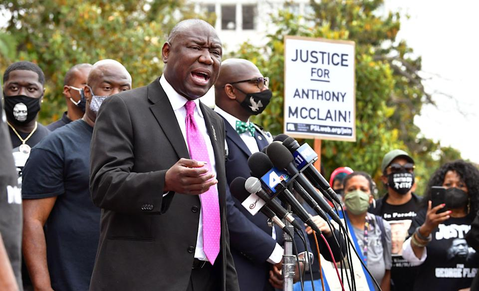 """Attorney Ben Crump, who led the legal team for George Floyd's family, gestures while addressing a crowd gathered in front of City Hall in Pasadena, California, on May 17, 2021. People gathered to demand accountability for the Anthony McClain, who was shot in the back by police in Pasadena in August 2020. McClain family dispute the police account of the shooting, alleging that officers """"planted"""" the gun to falsely justify the shooting, and that Anthony McClain was killed """"without warning"""" and """"without justification."""""""