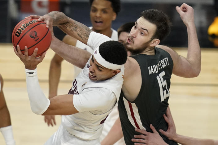 Arizona State's Jalen Graham, left, grabs a rebound over Washington State's Volodymyr Markovetskyy (15) during the first half of an NCAA college basketball game in the first round of the Pac-12 men's tournament Wednesday, March 10, 2021, in Las Vegas. (AP Photo/John Locher)
