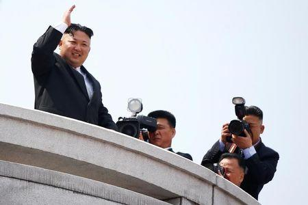 North Korean leader Kim Jong Un waves to people attending a military parade marking the 105th birth anniversary of country's founding father Kim Il Sung, in Pyongyang April 15, 2017. REUTERS/Damir Sagolj