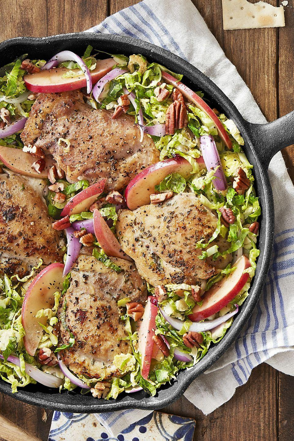 "<p>Sweeten skillet chicken with brown sugar and roasted apples.</p><p><strong><a href=""https://www.countryliving.com/food-drinks/recipes/a44233/skillet-chicken-brussels-sprouts-apples-recipe/"" rel=""nofollow noopener"" target=""_blank"" data-ylk=""slk:Get the recipe"" class=""link rapid-noclick-resp"">Get the recipe</a>.</strong><br></p><p><a class=""link rapid-noclick-resp"" href=""https://www.amazon.com/KitchenAid-Nylon-Slotted-Spoon-Black/dp/B005D6G2RG?tag=syn-yahoo-20&ascsubtag=%5Bartid%7C10050.g.648%5Bsrc%7Cyahoo-us"" rel=""nofollow noopener"" target=""_blank"" data-ylk=""slk:SHOP SLOTTED SPOONS"">SHOP SLOTTED SPOONS</a></p>"