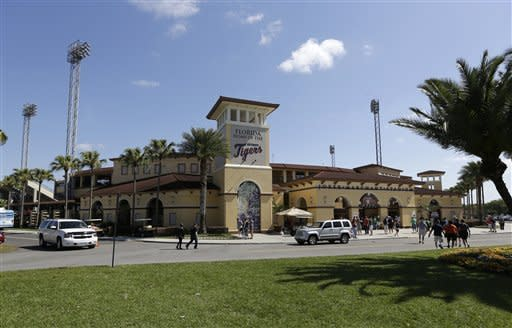Baseball fans begin arriving at Joker Marchant Stadium, home of the Detroit Tigers, for an exhibition spring training baseball game between the Tigers and the Washington Nationals, Sunday, March 10, 2013 in Lakeland, Fla. (AP Photo/Carlos Osorio)