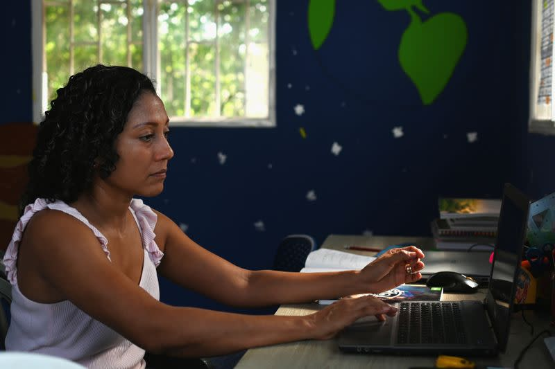 Claudia Patricia Fortich, widow of late oil tanker captain Jaime Herrera Orozco who was murdered on his ship while anchored off Venezuela, uses her computer to search for a job, at her home in Cartagena