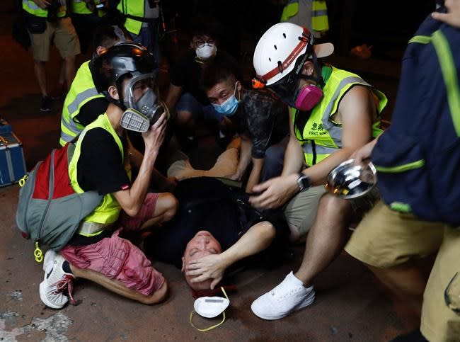The Latest: France presses for Hong Kong talks to end crisis