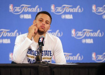 FILE PHOTO: June 19, 2016; Oakland, CA, USA; Golden State Warriors guard Stephen Curry (30) reacts while speaking to media following the 93-89 loss against the Cleveland Cavaliers in game seven of the NBA Finals at Oracle Arena. Mandatory Credit: Kelley L Cox-USA TODAY Sports  / Reuters  Picture Supplied by Action Images