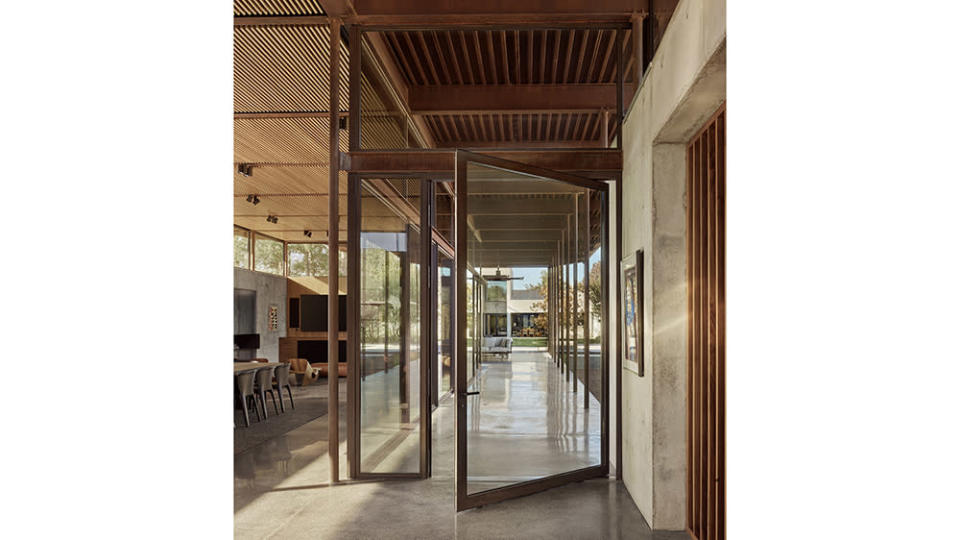 A look at the large glass doors and tall ceilings a part of the Lake Fiato designed home. - Credit: Casey Dunn