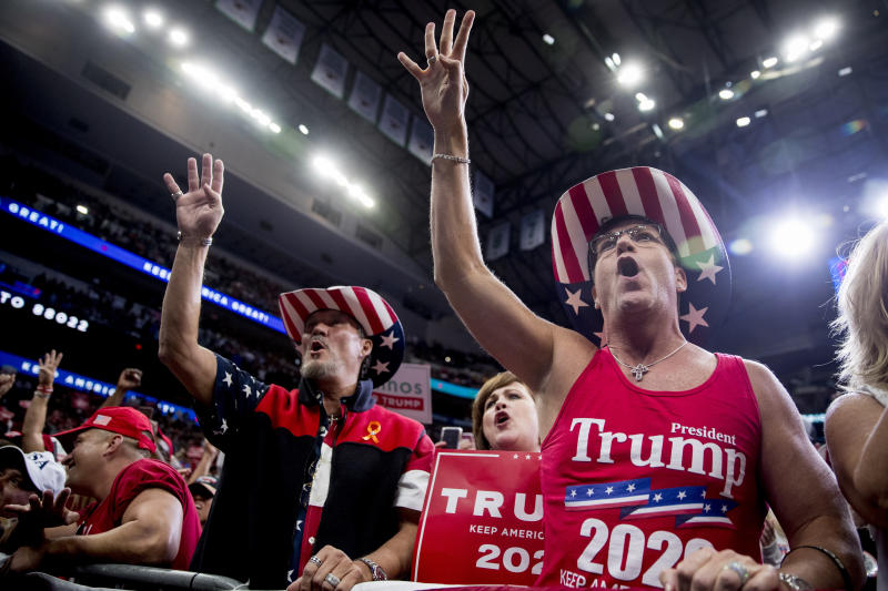 "Members of the audience wear ""Trump 2020"" cowboy hats and chant, ""Four More Years,"" as President Donald Trump speaks at a campaign rally at American Airlines Arena in Dallas, Texas, Thursday, Oct. 17, 2019. (AP Photo/Andrew Harnik)"