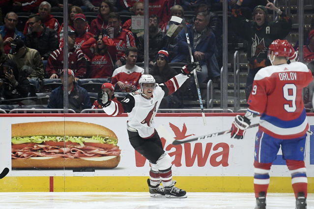 Arizona Coyotes right wing Michael Grabner celebrates his goal during the second period of an NHL hockey game as Washington Capitals defenseman Dmitry Orlov (9) looks on, Monday, Nov. 11, 2019, in Washington. (AP Photo/Nick Wass)