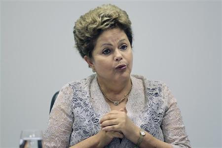 Brazil's President Dilma Rousseff speaks during the first meeting of the newly-formed CIASN, an interministerial committee for simplifying tax collection, at the Planalto Palace in Brasilia, February 12, 2014. REUTERS/Ueslei Marcelino