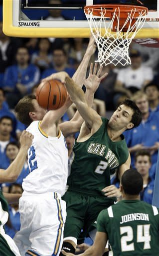 Cal Poly's Chris O'Brien (2) blocks UCLA's David Wear, left, during the first half of an NCAA college basketball game in Los Angeles, Sunday, Nov. 25, 2012. (AP Photo/Jason Redmond)