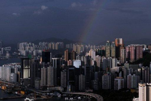 A rainbow is seen over residential and commercial buildings in Hong Kong in June 2012. The Kwoks are among Hong Kong's richest men and Sun Hung Kai is the city's biggest property developer by market capitalisation, having built some of the southern Chinese territory's biggest harbourside landmarks