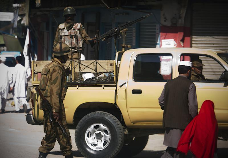 In this Thursday, Oct. 18, 2012 photo, Pakistani army soldiers patrol Mingora, Swat Valley. The Taliban's horrific attack on a female teenage activist in this scenic corner of Pakistan's northwest was the latest in a series of assassination attempts by militant sleeper cells in the area over the last year. The insurgents activated their networks in the Swat Valley to take advantage of the army's decision to reduce its presence, raising questions about the military's ability to hand over control to civilian authorities in areas where it has fought the Taliban, a fundamental part of its counterterror strategy.(AP Photo/B.K. Bangash)
