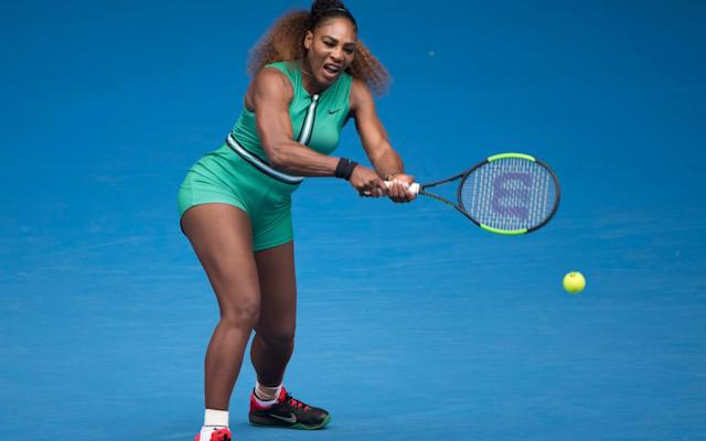 "Serena Williams wore a green all-in-one a jumpsuit that she referred to as a ""Serena-tard"" - Xinhua / Barcroft Media"