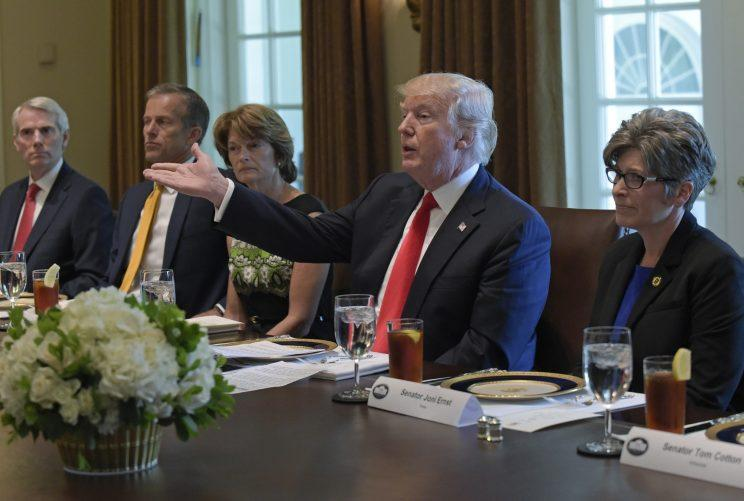 President Donald Trump speaks before having lunch with Republican Senators in the Cabinet Room of the White House in Washington, Tuesday, June 13, 2017. From left are, Sen. Rob Portman, R-Ohio, Sen. John Thune, R-S.D., Sen. Lisa Murkowski, R-Alaska, the president and Sen. Joni Ernst, R-Iowa. (Photo: Susan Walsh/AP)