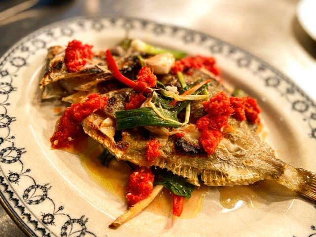 Whole grilled John Dory served Thai-style, in as un-Thai a setting as you can imagine (The Rocket Store)