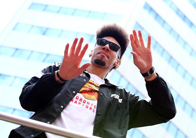 Danny Green waves to fans from his bus during the Toronto Raptors' championship parade on June 17, 2019. (Photo by Vaughn Ridley/Getty Images)