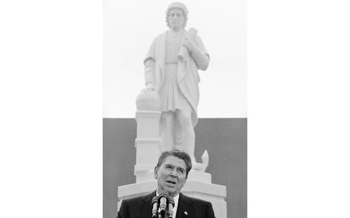 President Ronald Reagan addresses a ceremony in Baltimore, to unveil a statue of Christopher Columbus - AP