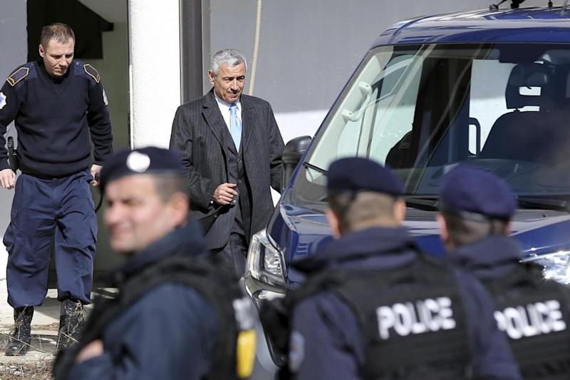 Doctors struggled to save the life of Kosovo Serb politician Oliver Ivanovic, shown here in 2017 leaving the prison in the northern, Serb-dominated part of Mitrovica (AP)