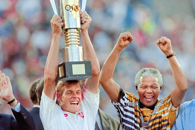 Neil Tovey celebrates with Nelson Mandela in 1996 after South Africa won the Africa Nations Cup (AFP Photo/Mykel Nicolaou)
