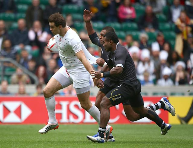 The Falcons' Alex Gray puts the moves on Fiji while playing for the English rugby team in 2016. (Getty Images)