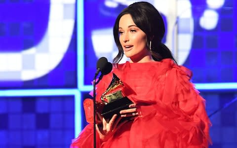 "Kacey Musgraves accepts the award for Album Of The Year for ""Golden Hour"" onstage during the 61st Annual Grammy Awards - Credit: AFP"