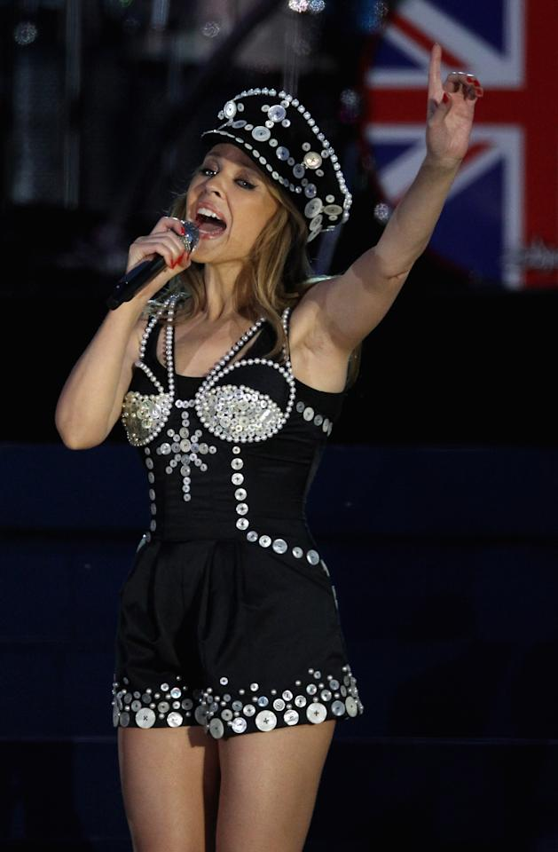LONDON, ENGLAND - JUNE 04:  Singer Kylie Minogue performs on stage during the Diamond Jubilee concert at Buckingham Palace on June 4, 2012 in London, England. For only the second time in its history the UK celebrates the Diamond Jubilee of a monarch. Her Majesty Queen Elizabeth II celebrates the 60th anniversary of her ascension to the throne. Thousands of well-wishers from around the world have flocked to London to witness the spectacle of the weekend's celebrations.  (Photo by Dan Kitwood/Getty Images)