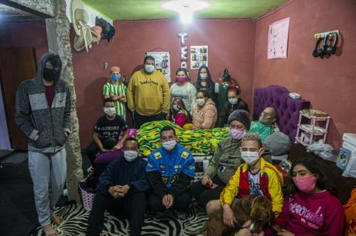 The Hernandez family, confined at their home in Lima, Peru, where most of them have fallen ill from the coronavirus