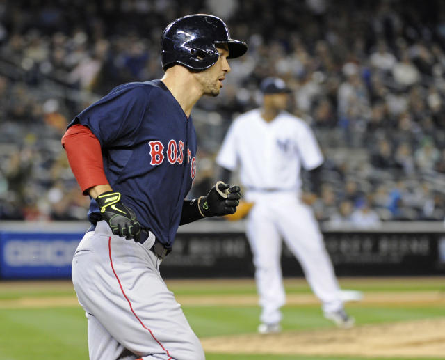 Boston Red Sox batter Grady Sizemore, left, rounds the bases after hitting a three-run home run as New York Yankees pitcher CC Sabathia looks on during the sixth inning of a baseball game Friday, April 11, 2014, at Yankee Stadium in New York. (AP Photo/Bill Kostroun)