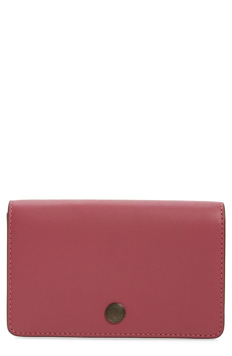 <p><span>COACH Foldover Leather Card Case</span> ($37, originally $99)</p>