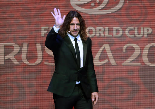 FILE - In this Friday, Dec. 1, 2017 file photo, former Spanish soccer international Carles Puyol arrives at the 2018 soccer World Cup draw in the Kremlin in Moscow. The former captain of Spain's national soccer team, Carles Puyol, is claiming that Iranian TV officials barred him from appearing as a World Cup commentator because of his long hair. Iranian officials have denied the claim. The report on Saturday, June 23, 2018 by Jam-e Jam newspaper's TV affiliate quotes government TV official Morteza Mirbagheri as saying the issue was about money not hair. (AP Photo/Ivan Sekretarev, file)