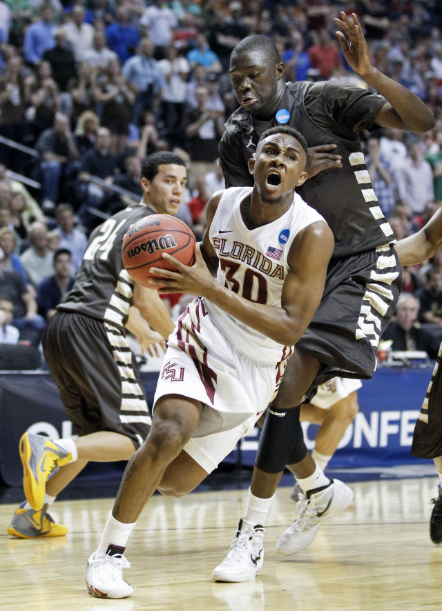 Florida State guard Ian Miller (30) drives against St. Bonaventure defenders Youssou Ndoye, right, and Matthew Wright (24) in the first half of a second-round NCAA college basketball tournament game on Friday, March 16, 2012, in Nashville, Tenn. (AP Photo/Mark Humphrey)