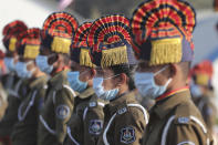 Police officials wearing face masks as precautions against COVID-19 participate in India's Republic Day celebrations in Ahmedabad, India, Tuesday, Jan. 26, 2021. Republic Day marks the anniversary of the adoption of the country's constitution on Jan. 26, 1950. (AP Photo/Ajit Solanki)
