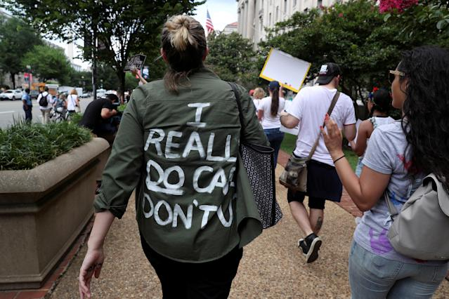 "<p>A protester wears a top reading ""I really do care, Don't U"" as she joins demonstrators rally and march calling for ""an end to family detention"" and in opposition to the immigration policies of the Trump administration in Washington, D.C., June 28, 2018. (Photo: Jonathan Ernst/Reuters) </p>"