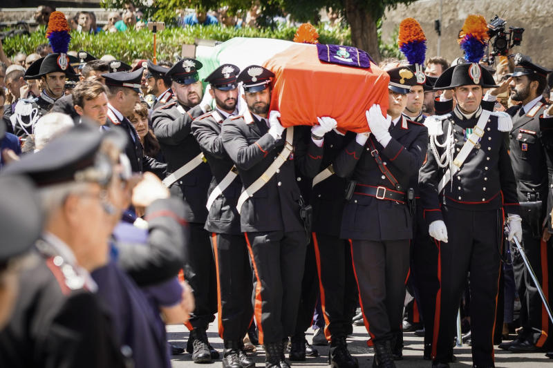 The coffin containing the body of the Carabinieri's officer Mario Cerciello Rega is carried during his funeral in his hometown of Somma Vesuviana, near Naples, southern Italy, Monday, July 29, 2019. Two American teenagers were jailed in Rome on Saturday as authorities investigate their alleged roles in the fatal stabbing of the Italian police officer on a street near their hotel. (Cesare Abbate/ANSA via AP)