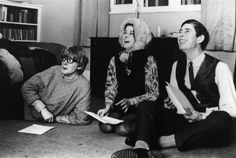 1969: Charles, Prince of Wales reading through a play with his undergraduate friends whilst sitting on the floor of a Cambridge study. (Photo by Central Press/Getty Images)