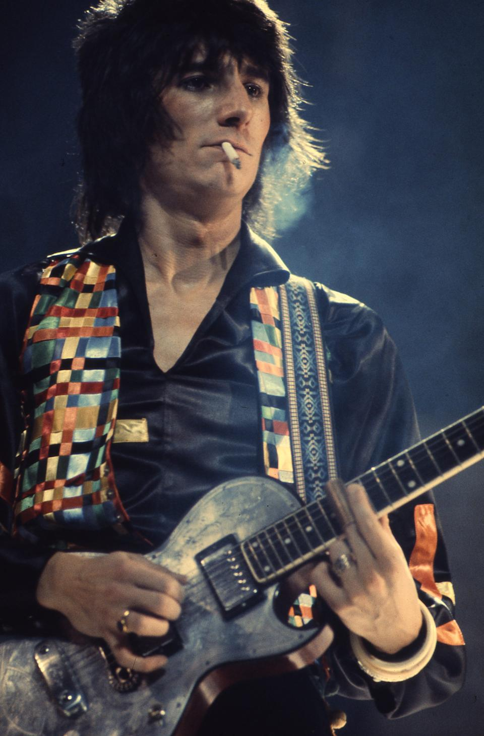 British guitarist Ronnie Wood of the Faces performing on stage in 1972. (Photo by Michael Putland/Getty Images)