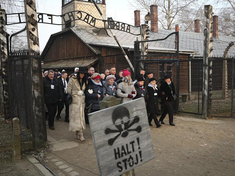 The president of Poland Andrzej Duda walks with survivors through the gates of Auschwitz to attend the 75th anniversary commemorations: AP