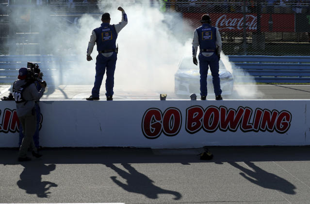 Chase Elliott does a celebratory burnout in front of his pit crew after winning a NASCAR Cup Series auto race at Watkins Glen International, Sunday, Aug. 4, 2019, in Watkins Glen, N.Y. (AP Photo/John Munson)