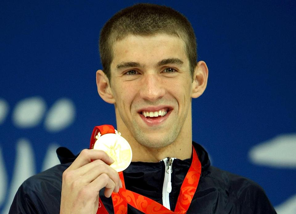 <p>Michael Phelps receives his gold medal during the medal ceremony for the 400m individual medley event at the Beijing 2008 Olympic Games on August 10, 2008. Phelps finished the race in a time of 4:03:84, a new World Record. (Al Bello/Getty Images)</p>